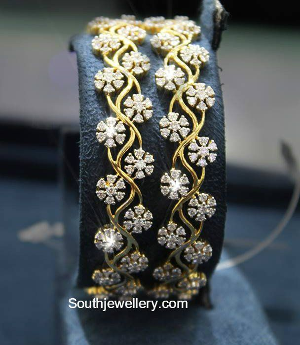 18 carat gold floral design bangles studded with diamonds. Related PostsFloral Diamond BanglesLatest Diamond BanglesDiamond BanglesDiamond Navaratna BanglesDiamond Haram SetBroad Diamond Bracelet