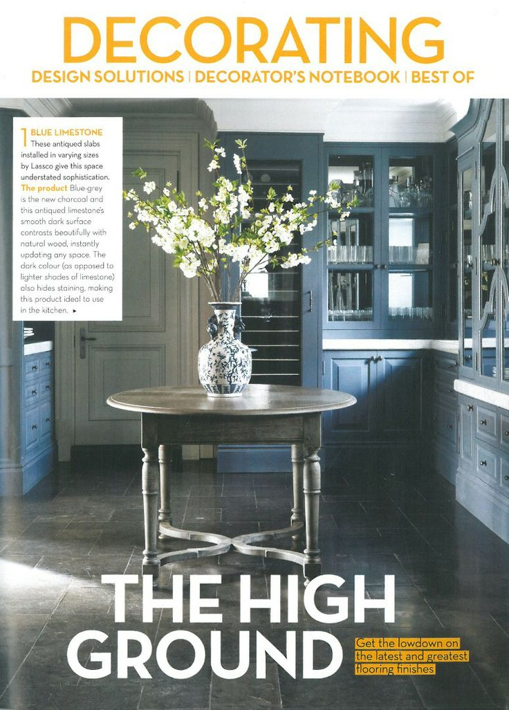 A Pierre Cronje custom gate leg oval kitchen table is the centrepiece in this kitchen.  Featured  in Conde Nast House & Garden South Africa