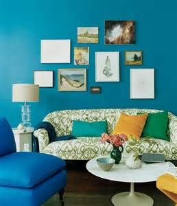 green blue walls paint: peacock blue living room eclectic living room domino magazine