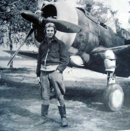 """Finnish Airforce fighter ace (32 victories) Kyösti """"Kössi"""" Karhila (1921–2009) photographed infront of his Curtiss P-36 Hawk after his first kill in august 1941.  He flew the Curtiss Hawk in LeLv 32 until April 20, 1943, when he was moved to LeLv 34 along with some other aces, to fly the just arrived Messerschmitts. During the Continuation War (1941-1944) Karhila, scored 13 confirmed kills with the P-36 Hawk and 19 with Bf 109 G, flying 556 hours (304 missions) and also reached ..."""