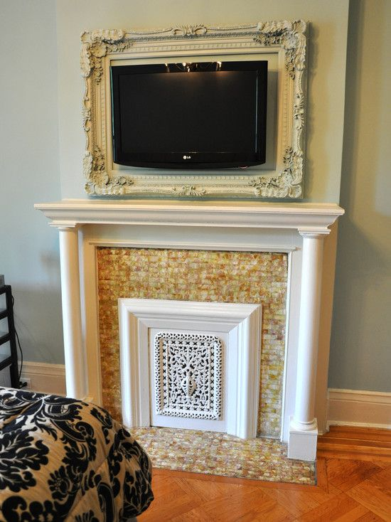Don't you love the way the television has been framed like a work of art above the old fashioned looking fireplace and mantel?