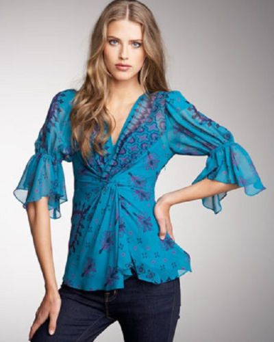 Nanette Lepore Wishful Top Teal Size10 Retails for $298.00 on Sale for $225.00. Drawing on the Nanette Lepore's signature attention to detail, this exquisite top is crafted from gorgeous teal silk.  Striking graphic print in lovely shades of purple and navy. Wear this vibrant Teal print blouse from Nanette Lepore across all seasons.