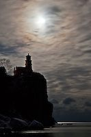 """""""Split Rock Lighthouse under an Iridescent Sky""""<br /> <br /> The night before the January full moon, we enjoyed some night photography at Split Rock Lighthouse State Park. The iridescence in the clouds occurs when the moonlight is scattered or bent as it passes through ice crystals in the clouds. The sky created an excellent mood during the photo shoot."""