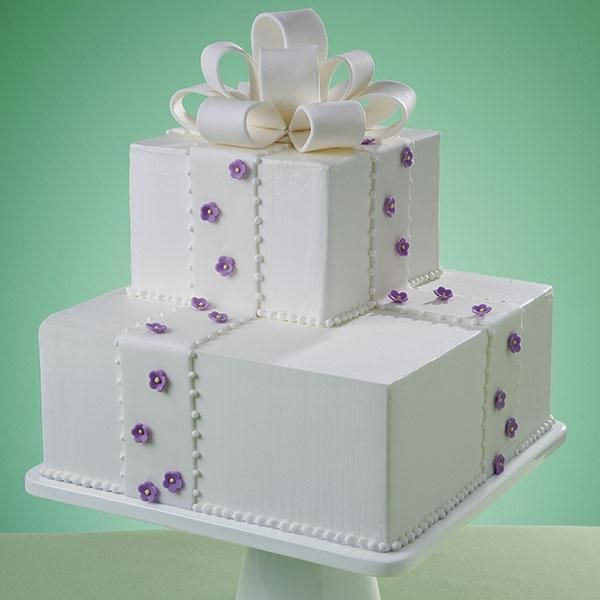"""""""Simple Violet Elegance Cake""""   Randomly placed gum paste violets add a dash of charm to this breathtakingly beautiful cake."""