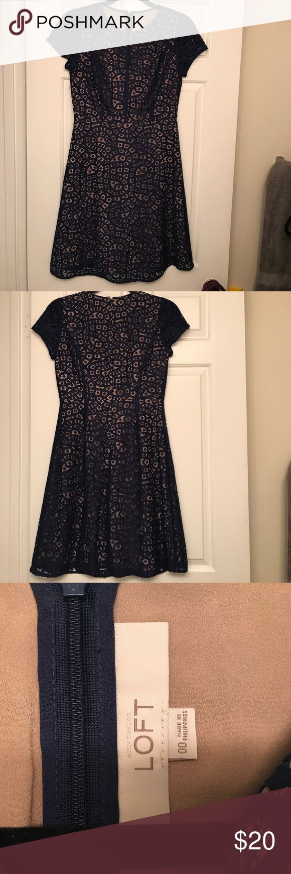 Ann Taylor Loft navy lace detailed dress This is the perfect wedding guest dress! It is a 00, knee length dress with a tan skirt underneath and blue lace details on top. Ann Taylor Dresses Mini