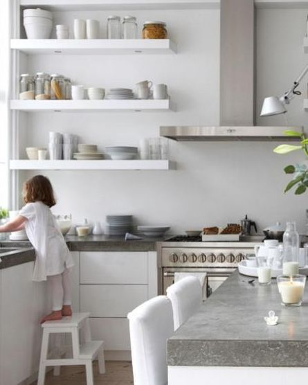 open shelves and concrete worktop. Oh, and a child.