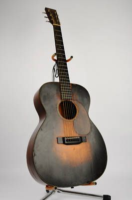 Iconic 1934 pre-war Martin 000 guitar. - okay so not his exact guitar, but something like it.