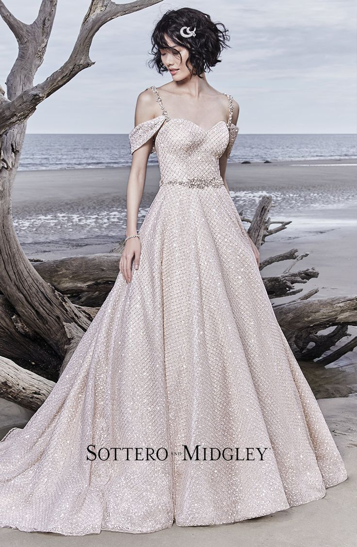 With a sweetheart neckline and a Swarovski crystal beaded belt