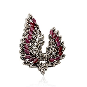 Retro collection. Delicate brooch made of sterling silver, marcasite and rubies. Tax free $63.90
