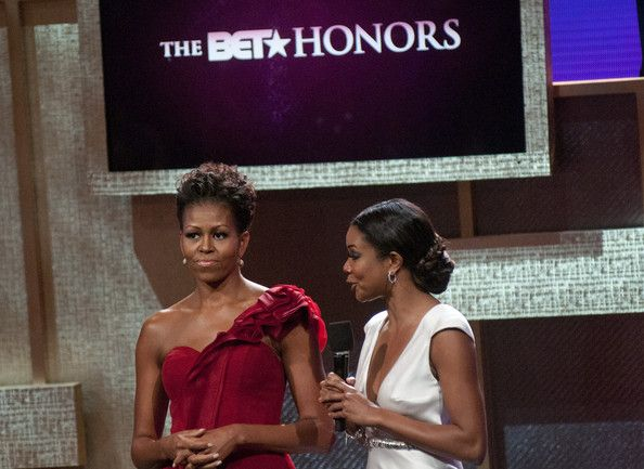 Michelle Obama Photos Photos - Michelle Obama and Gabrielle Union speak during the BET Honors 2012 at the Warner Theatre on January 14, 2012 in Washington, DC. - BET Honors 2012 - Show