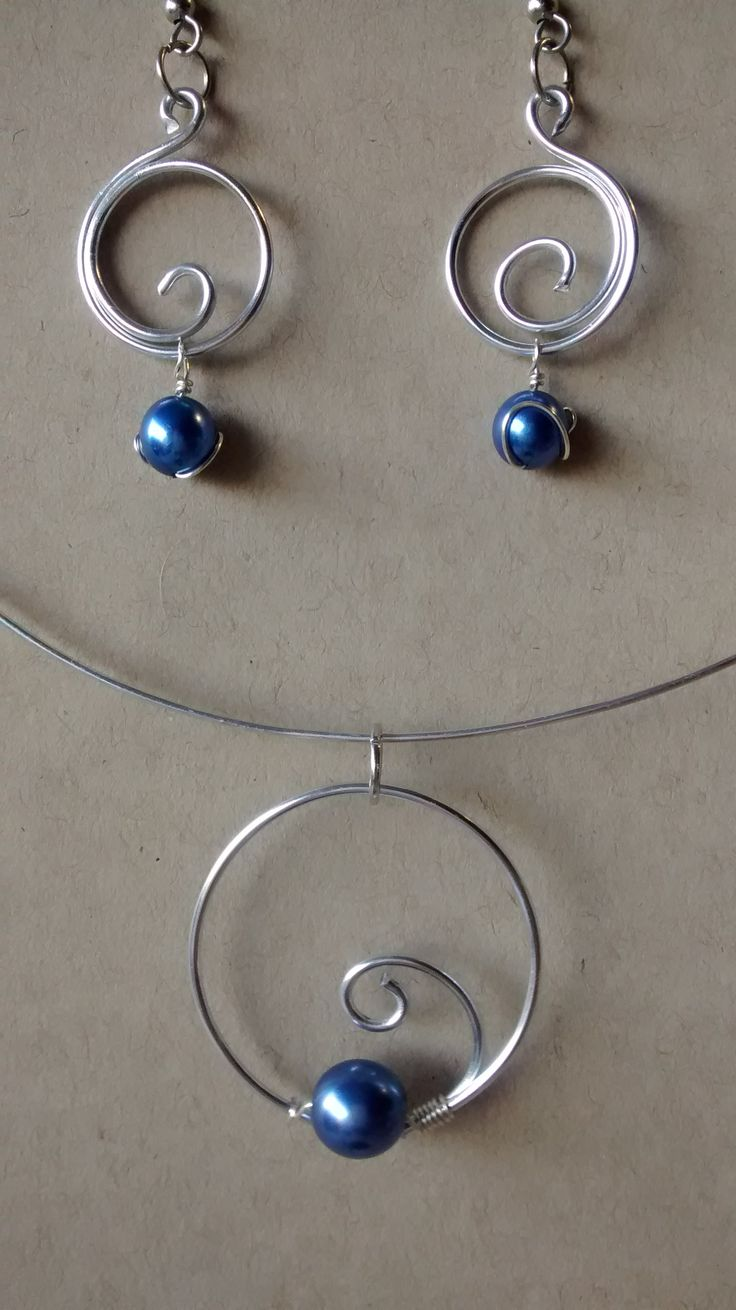 Blue swirl set. Silver aluminum wire, blue glass beads. Pendant comes with adjustable silk cord. $15.00 for set and free shipping.