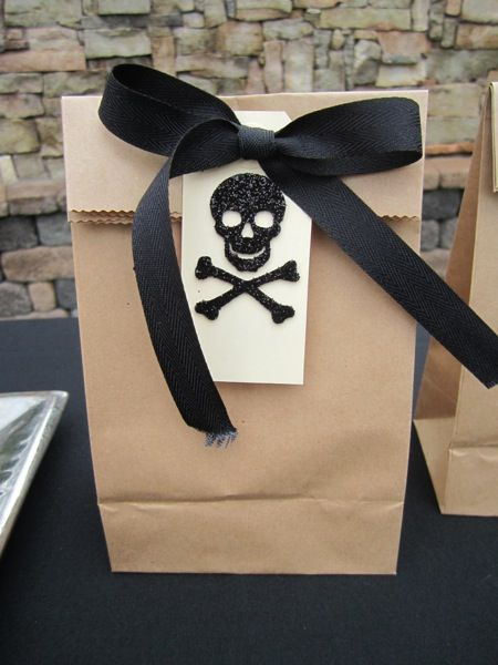 Goody bags for your little pirate. Love the glitter skull and cross bones.