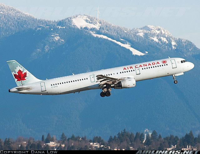 Air Canada Airbus A321-211 (C-GITU) taking off from Vancouver airport, with Grouse Mountain ski slopes visible in background.