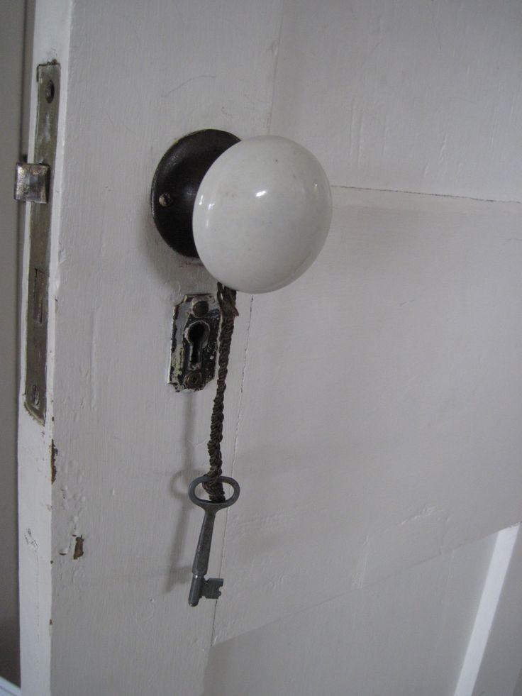 Old door knob and key, Toabh Na Mara Cottage, Pugwash, Nova Scotia, Canada.  Photo Cynthia Bennett.