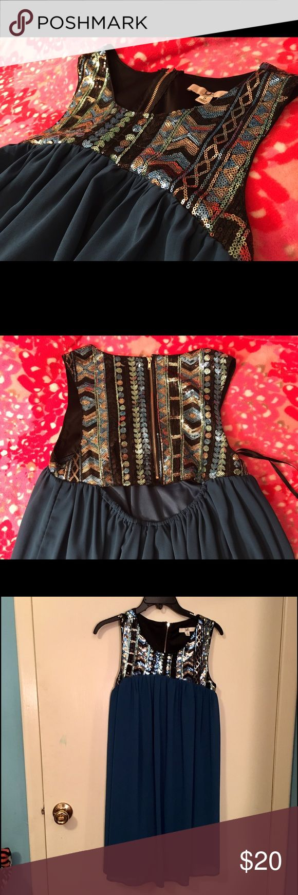 Sequin party dress 👗 Sequin dress. Top half is black with black, gold, and blue sequins which create Aztec and boho patterns. The bottom half is blue fabric. Great for prom or a party dress. I'm 5 ft and the dress is a little above my knees. Please comment with any questions! Ya Los Angeles Dresses Prom