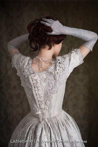 Trevillion Images - historical-woman-adjusting-hair