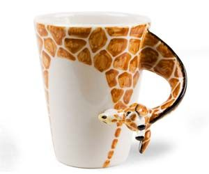 Enjoy a cup of coffee in the morning with this cute giraffe cup that cleverly uses the neck of the giraffe as the cup handle. These giraffe cups are all individually hand made, so each one is unique and makes for a great collectible cup to store in your cupboard.