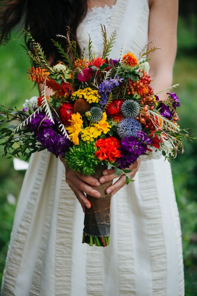 Wild flowers make a gorgeous + bright wedding bouquet.