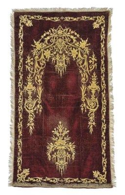 BURGUNDY VELVET PRAYER ARCH (NAMAZLIK)  OTTOMAN, CIRCA 1900  embroidered in couched gilt thread with a mehrab of flowers and arabesques, with a flower filled urn below 34 x 62ins. (82 x 149cms.)
