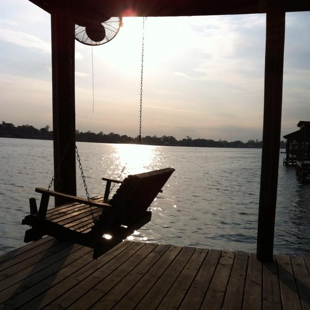 Swing, fans, dock, and friends. False River in New Roads, la