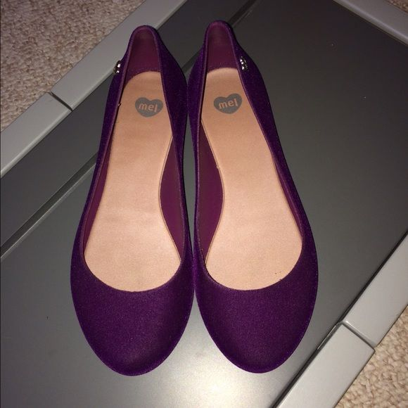 Melissa Flats - Deep Purple *RESERVED* This flats is very comfortable as all Melissa's shoe lines! Great for casual wear daily! Wore this once. In still really good condition and still looks clean except for the bottom of the flats. This also comes shoe bag by Melissa. Melissa  Shoes Flats & Loafers