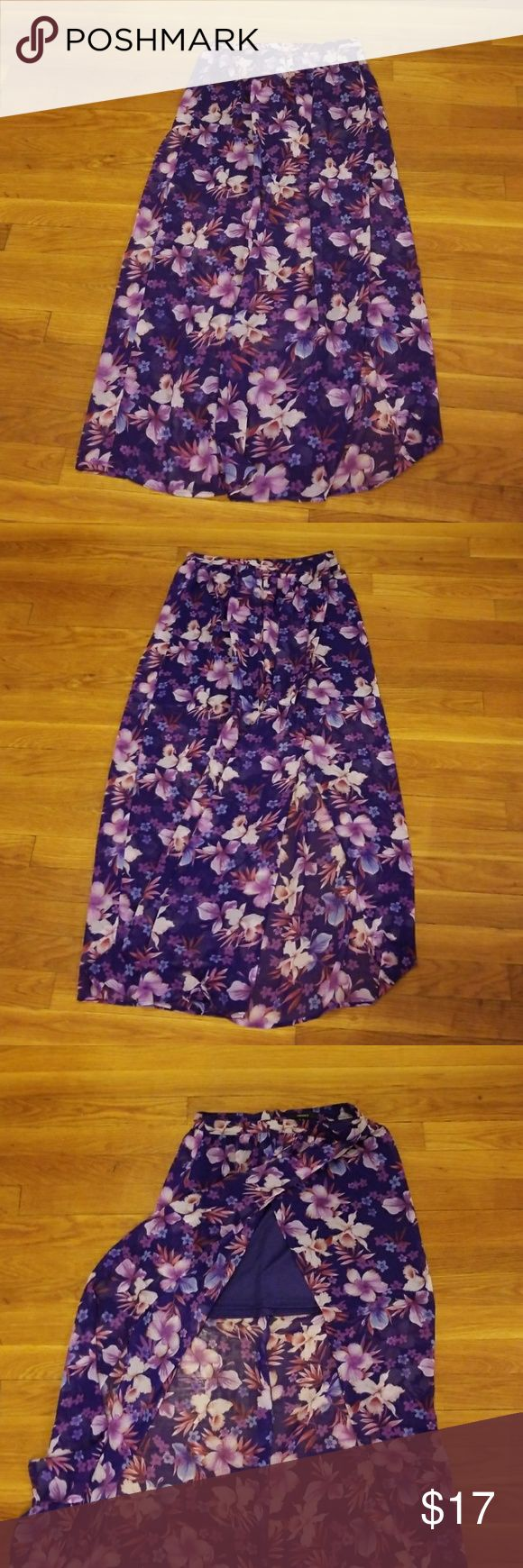 """F21 Maxi Floral Print Skirt Cute Maxi purple floral print skirt with a sarong style look. Has a dark purple lined mini skirt. Zippers in the back and hooks as well. Great for vacation or tropical getaways  38"""" in length Forever 21 Skirts Maxi"""