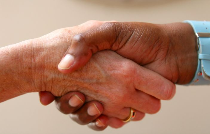 """""""You cannot shake hands with a clenched fist"""" --Indira Ghandi #nationalhandshakeday #SparkConnections #IndigoEnergy"""