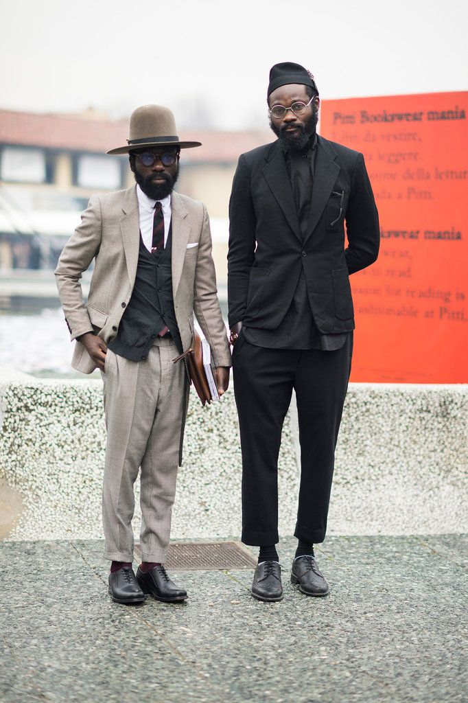 Street Style From Pitti Uomo - NYTimes.com. Liking the all black suit and that tan hat.