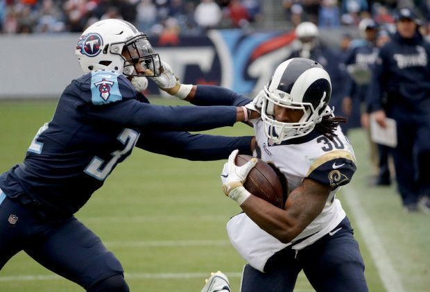 Game #15 2017: Rams wins NFC West, 27-23 win Titans in Nashville. Rams at 11-4 NFC West Title in 14 yrs (2003). Rams RB30 Todd Gurley tries to break...away! (google.image) 12.24.17 (Sun) #5/7