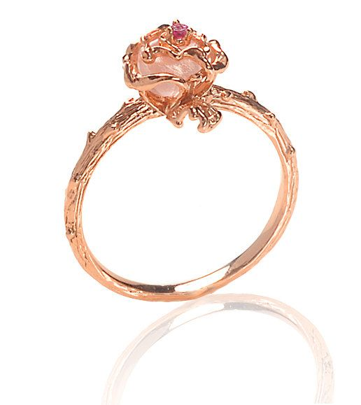 Elegant Rose Gold plated rose ring with vine detailed band compliments with Rose Quartz semi-precious center stone and a tiny Ruby stone on top for