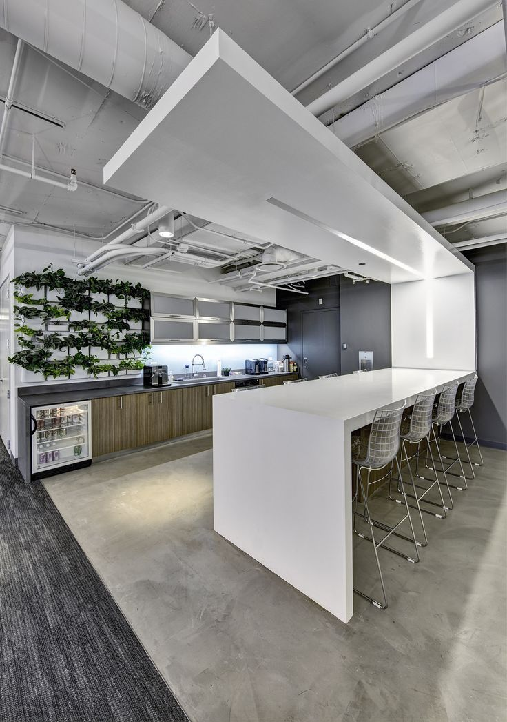 amicus interiors office photo featuring brick pantry area partition pendant lighting picnic table plants