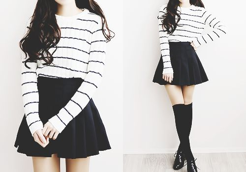Cute monochromatic outfit with the white and black striped top, black flared skirt, and black thigh highs.