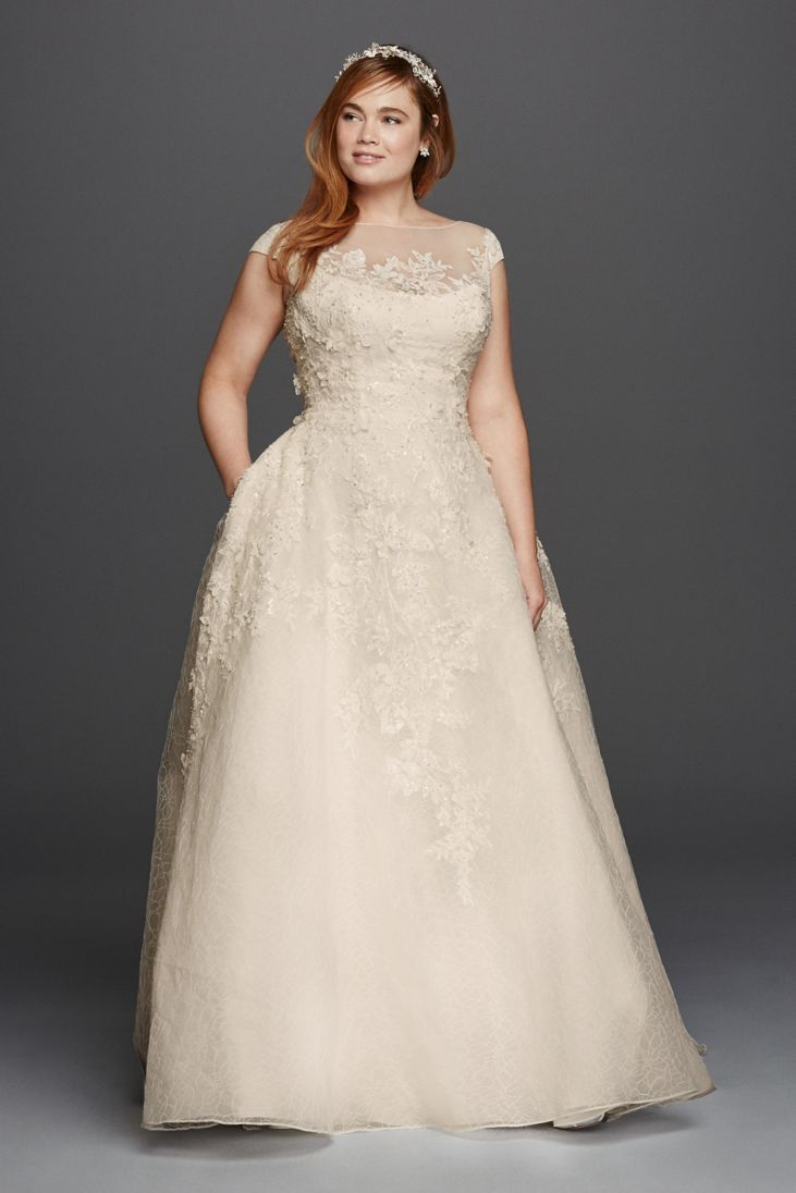 Wedding Dress with Three Dimensional Flowers - 24 Elegantly Tailored Wedding Dresses for Pear Shaped Body - EverAfterGuide