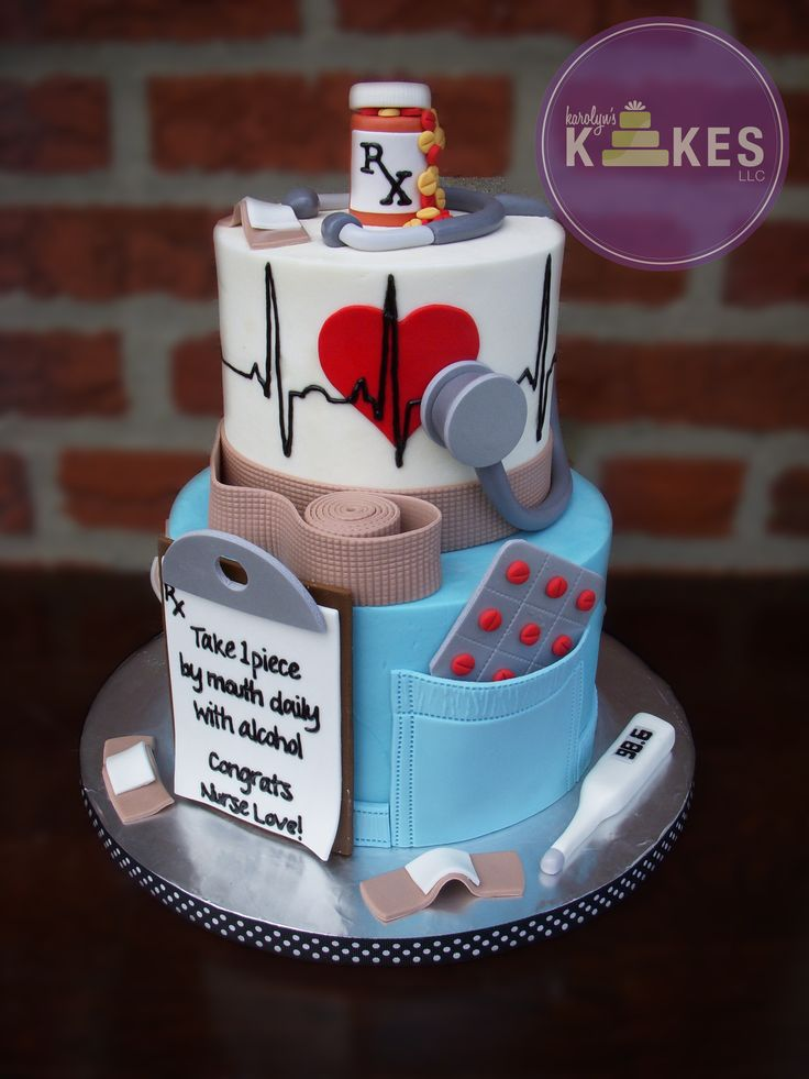Nurse Graduation cake Cakes are iced in buttercream. Stethoscope, pill pack, band-aids, thermometer, clipboard, prescription are marshmallow fondant.