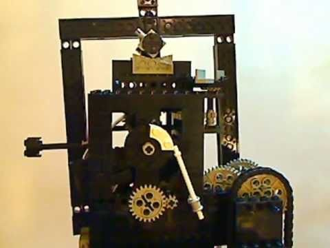 """Not exactly a """"fine movement clock"""" but worthwhile listing with the other clocks. Lego clock component - robin remontoire with drop cam - YouTube"""