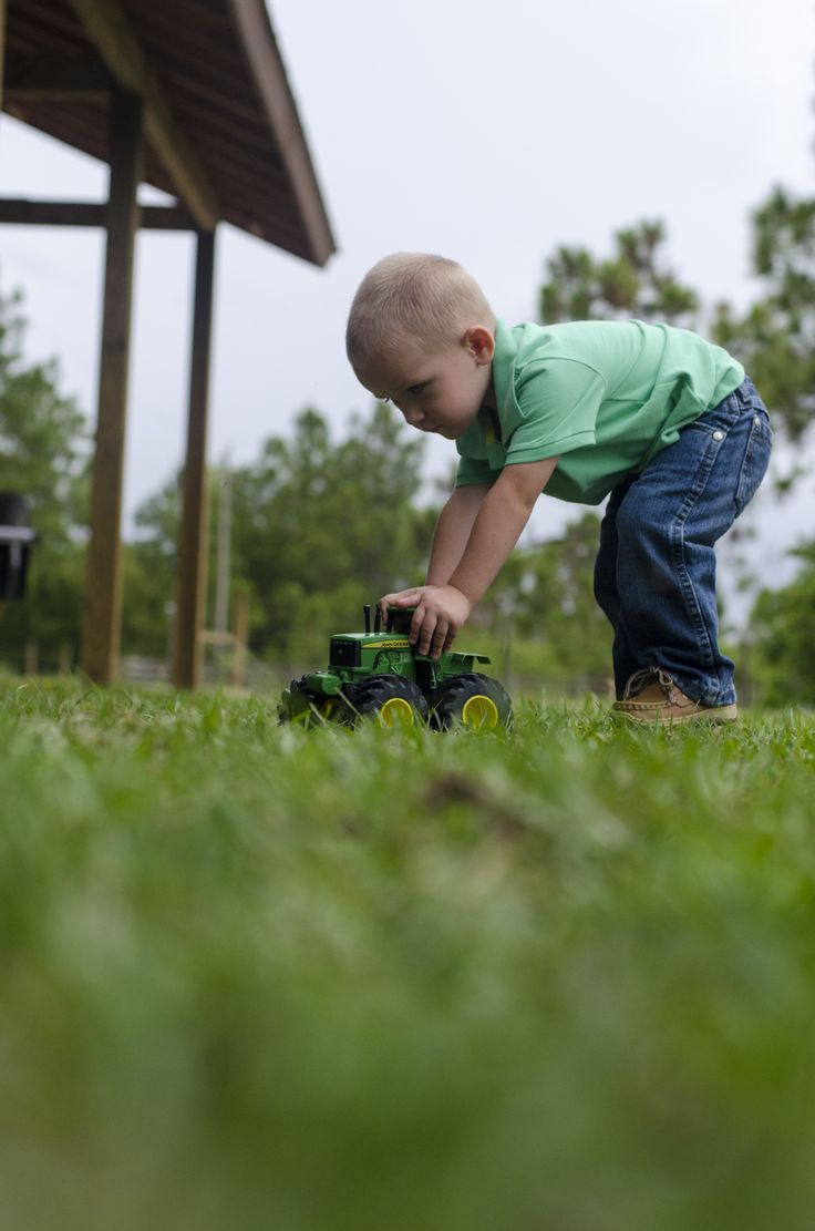 down on the farm, playing with the tracker enjoying his 2nd birthday photo shoot. Ft. Myers, Florida
