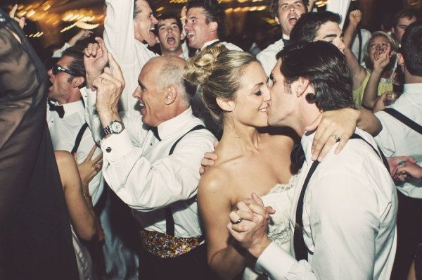 The best photo to get at your reception -- a stolen kiss!   http://weddingpartyapp.com/blog/2014/01/23/10-unique-wedding-photo-poses-ideas-inspire/