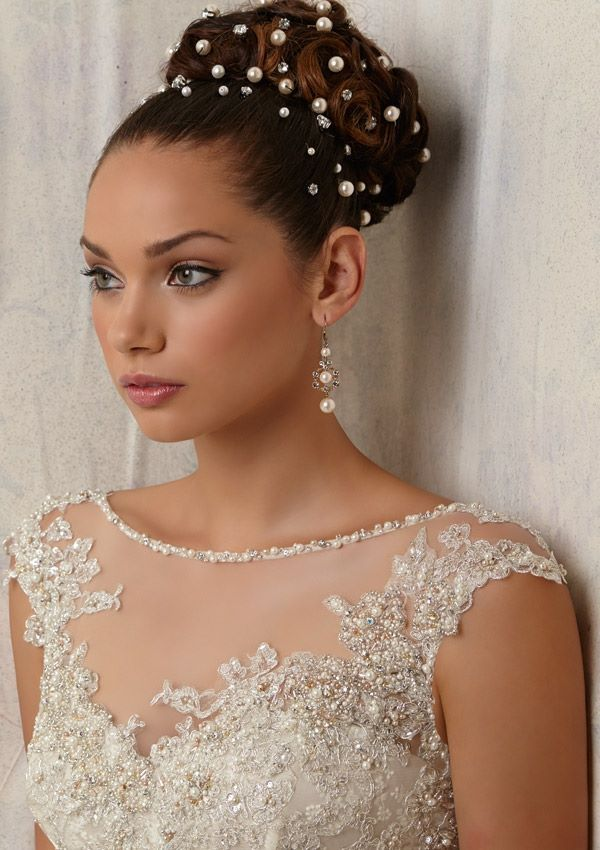 Style NOLX Beaded Appliqués Over Embroidery on Net Colors Available: Ivory, Oyster. Sizes Available: 2-28.