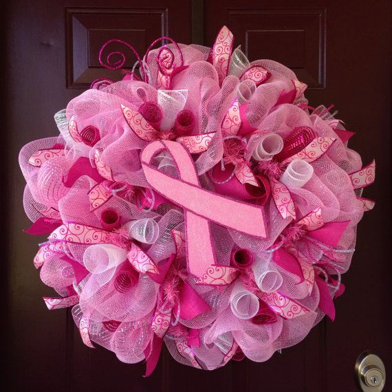 This wreath is made from pink and white deco mesh with a hand painted glittery awareness ribbon. It has two different colors of ribbon and