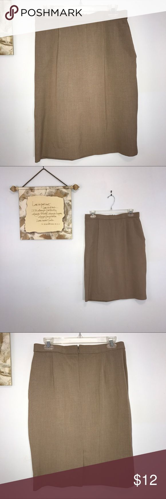 """Counterparts Tan Pencil Skirt Size 10 Counterparts tan pencil skirt. Has Black front panel for tummy control. 6"""" rear split. Lying flat, approximate measurements are: waist 15""""; hip 21""""; length 23"""". (F02-015) Skirts Pencil"""