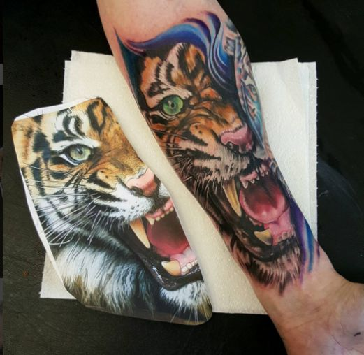 Pin By Laura Kuley On Tattoo: Hard To Tell Which Is Which. Tattoo By Laura Charlton