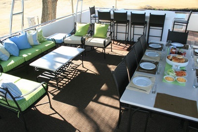 Top deck with lounge and dining area, jacuzzi and gas braai facility