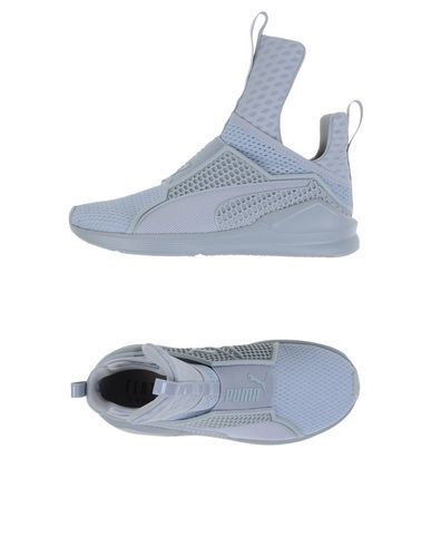 Rihanna X Puma Fenty Trainer - Women Sneakers on YOOX. The best online selection of Sneakers Rihanna X Puma. YOOX exclusive items of Italian and international designers -...