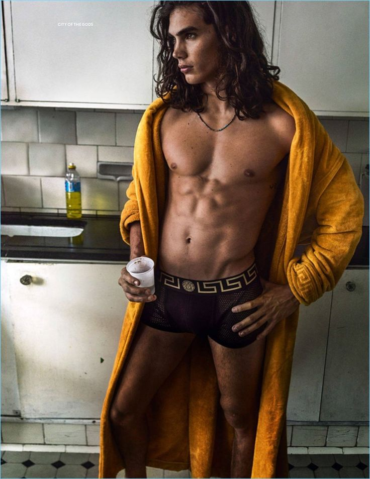 Model Vito Basso lounges in a yellow Versace robe and underwear.