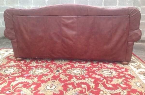 Haverty's nail studded, tufted leather couch. Camel back. Prerequisites for eventual couch - need to be able to lay down and not feel squished (heightwise), padded armrests (can double as pillows), and color/material must be brown leather or distressed looking brown leather (even better)!