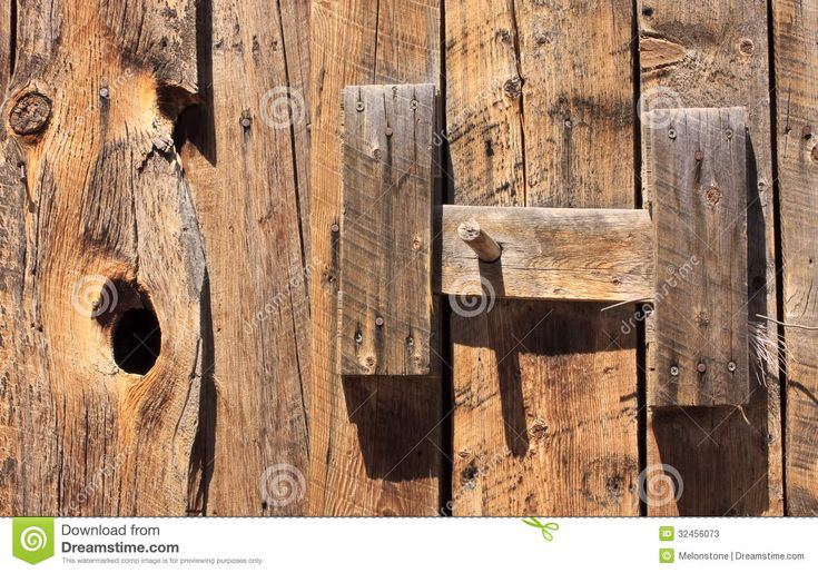 Detail of the original simple wooden latch handle on a timber barn door on an historic American ranch in Colorado, USA. Description from dreamstime.com. I searched for this on bing.com/images