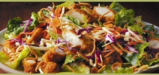 APPLEBEE'S ORIENTAL DRESSING: *3 T honey, *1 1/2 T rice wine vinegar, *1/4 C mayonnaise, *1 tsp Dijon mustard, *1/8 tsp sesame oil, ~ *3 cups chopped romaine lettuce, *1 cup red cabbage, *1 cup Napa cabbage, *1/2 carrot, julienned or shredded, *1 T sliced almonds, *1/3 cup chow mein noodles
