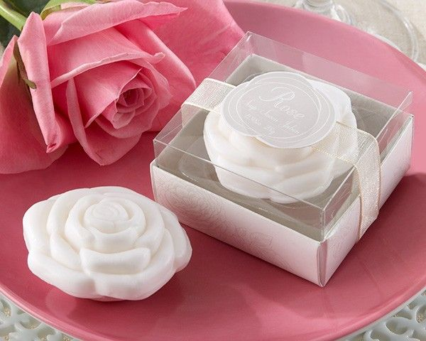 """When everything's coming up roses, you want to share it with the world. Here's a beautiful way to do just that--a finely detailed, white rose soap with a fresh fragrance as intoxicating as the flower itself. Features and facts:White, delightfully scented, rose-shaped soapSoap measures approximately 2"""" in diameterGift presentation includes a clear display cover on an antique-white base with subtle rose design, a white-organza band with a graphic rose applique Gift box measures approximately 1…"""