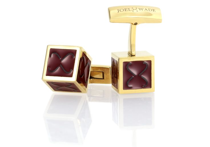 'Auric' Cufflinks by Joel Wade.  Crafted in stainless steel featuring a deluxe gold finish  complemented by a rich burgundy lacquer and repeating Joel Wade vintage symbols on each side of the cufflink shape.