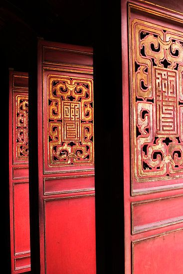 Ornate doors at the entrance to Ngoc Son Temple on Hoan Kiem Lake in the middle of the Old Quarter of Hanoi, Socialist Republic of Vietnam.
